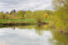Great ouse river with top of Odell church Royalty Free Stock Image