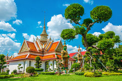 Great Palace Buddhist temple in Bangkok, Thailand. Great Palace Buddhist temple with famous green tree gardens in center of Bangkok, Thailand Royalty Free Stock Images