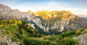 Great panoramic view to mountains and valley in sunset light with alpenglow. Stock Photos