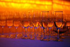 Great party!. A lot of wineglasses with champagne standing at the colorful background . Yellow, red and blue colors Stock Images