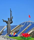 Great Patriotic War museum in Minsk near Obelisk, Stela monument. Statue symbolizes motherland, victory and freedom. Decorations in colors of Belarus flag: red royalty free stock photo