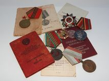 The great Patriotic war, orders, documents and medals on a white background, by February 23. stock photo