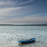 Great Peaceful evening at the bay. The sight of a peaceful bay with a anchored small fishing boats Stock Photo