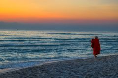 Sunrise at gulf of thailand in Hua Hin whit a monk royalty free stock photos