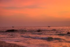 Sunrise at gulf of thailand in Hua Hin with Fisher Boat. This great photo shows the sunrise of Hua Hin in Thailand early morning at sunrise. You can see very royalty free stock images