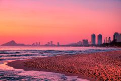 Sunrise at the gulf of thailand in hua hin out with the city in the background. This great photo shows the sunrise of Hua Hin in Thailand early morning at royalty free stock image