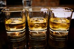 Whiskey with ice. Great photo on whiskey with ice on the black table Royalty Free Stock Photo