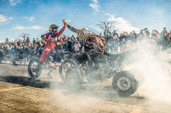 Great photograph of a stunt being performed by two motorcycles Royalty Free Stock Photos