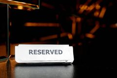 Reserved on the table. A great photography of the `Reserved` sign on the table Royalty Free Stock Photography