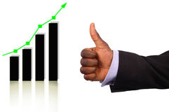 Great Profits!. This is an image of a businessman's hand giving thumbs up, due to the rise on the graph Royalty Free Stock Photo