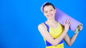 Great progress. Athlete yoga coach. Yoga class concept. Yoga as hobby and sport. Practicing yoga every day. Girl slim. Fit athlete hold fitness mat. Fitness and royalty free stock photo