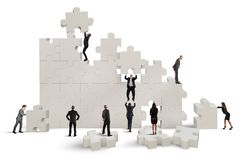 Great puzzle. Business team working to build a puzzle Stock Images