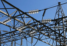 Great pylon of high voltage cables with tempered glass insulator Royalty Free Stock Image