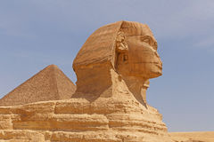 Great Pyramid behind Great Sphinx. Of Giza Royalty Free Stock Photos