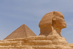 Great Pyramid behind Great Sphinx in Giza. Egypt Stock Photos