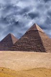 Great Pyramid Cheops in Giza, Egypt Travel. The Great Pyramid of Cheops in the Giza strip outside of Cairo, Egypt. The pyramids are a popular travel destination Stock Photos