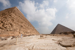 Great Pyramid of Cheops  from Khafre. Great Pyramid of Cheops (Khufu). View from the Pyramid of Khafre (chephren) with an Egyptian policeman in the foreground Stock Photography