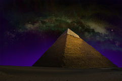 Great Pyramid, Egypt, Sky Stars. Artistic rendition of the great pyramid of Cheops in Giza, outside of Cairo, Egypt. The stars and Milky Way in the night sky royalty free stock images
