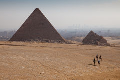 Great Pyramid of Giza. Scenic view of Great Pyramid of Giza with people walking in foreground desert, Egypt Royalty Free Stock Photography