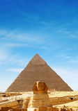 Great Pyramid - Giza, Egypt. The Sphinx and the great Pyramid at Giza in Egypt Stock Image