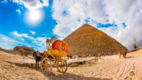 The great pyramid of Giza. Horse with carriage and camels in front of the great pyramid of Giza, Egypt Stock Images