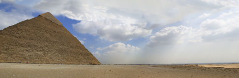 Great Pyramid of Giza panorama. Large panorama with Cairo skyline and the Great Pyramid at Giza Royalty Free Stock Image