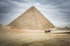 The Great Pyramid of Khufu at Giza. With horse and carriage in the foreground and Queen Hetephere's tomb on the right Royalty Free Stock Photos