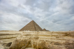 The Great Pyramid of Khufu at Giza. With Queen Hetephere's tomb on the right Royalty Free Stock Photos