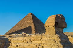 The Great Pyramid and sphinx stock photography