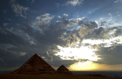 The Great Pyramids. Of Egypt under a sunset sky stock images