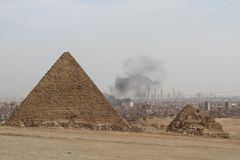 Great Pyramids and air pollution Royalty Free Stock Photo