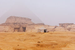 Great pyramids. Famous Sphinx and the great pyramids in fog and smog, Giza, Cairo, Egypt stock photo