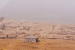 Great pyramids. Famous Sphinx and the great pyramids in fog and smog, Giza, Cairo, Egypt stock images