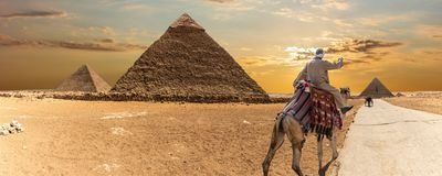 The Great Pyramids of Giza and a bedouin, desert panorama.  royalty free stock photos