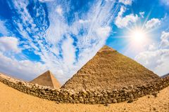 Great Pyramids in Giza. Egypt, with blue sky and bright sun Stock Photo