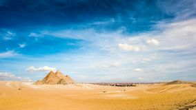 Great Pyramids of Giza, Egypt. Panorama of the Great Pyramids of Giza, Egypt, Skyline of Cairo in the background royalty free stock images