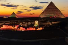 The Great Pyramids of Giza, enlighted at night, Egypt.  stock photography
