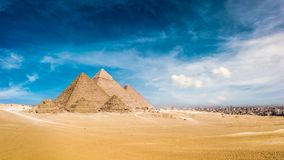 Great Pyramids of Giza. Panorama of the Great Pyramids of Giza, Egypt, with the skyline of Cairo in the background royalty free stock image
