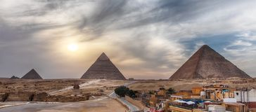 The Great Pyramids of Giza, panoramic view from the town.  royalty free stock photos