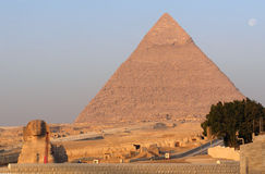 The Great Pyramids of Giza and Sphinx. Near Cairo in Egypt at sunrise royalty free stock images