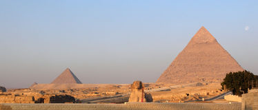 The Great Pyramids of Giza and Sphinx at sunrise Stock Photos