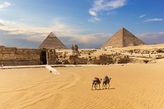 The Great Pyramids, the Sphinx and the temple entrance in Giza, Egypt. Africa ancient arabic archeology architecture bedouin cairo camel cheops chephren culture royalty free stock photography