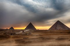 The Great Pyramids at sunset, Giza, Egypt. The Great Pyramids at sunset in Giza, Egypt royalty free stock image