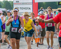 A great relief is felt just after crossing the triathlon finish line royalty free stock images