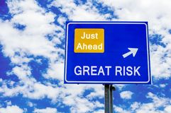 Great risk, just ahead blue road sign over dramatic cloudy sky stock photos