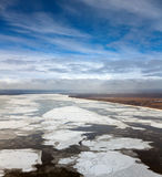 Great river with floating ice floes Stock Photo