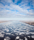Great river with floating ice floes Stock Images