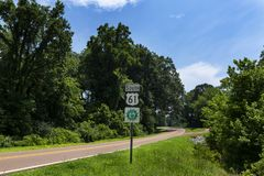 A Great River Road Sign along the US Route 61 near the city of Viksburg, in the State of Mississippi;. Concept for travel in America and road trip in USA royalty free stock images