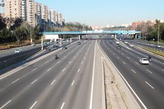Large multi-lane road with vehicles crossed by a bridge royalty free stock photography