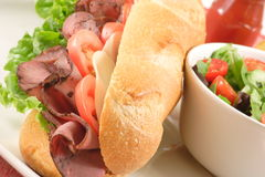 Great roast beef sandwich and salad Royalty Free Stock Image